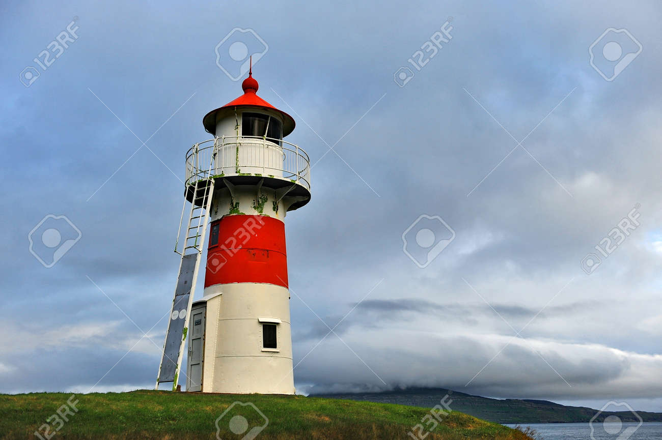 Lighthouse on the shore of the Atlantic Ocean. - 147032295