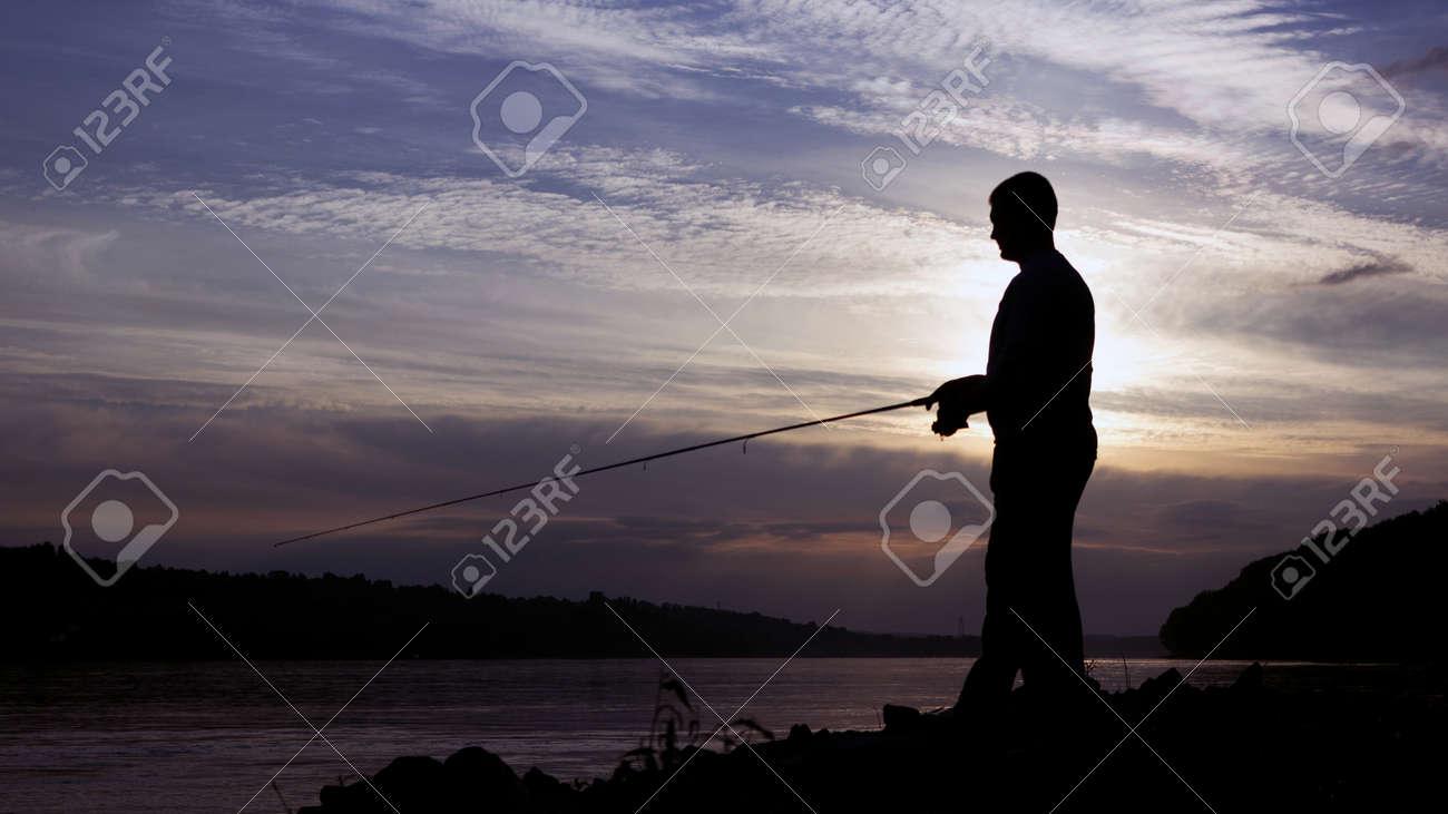 Silhouette of Fisherman on sunset, Fisherman Casting - 46721588