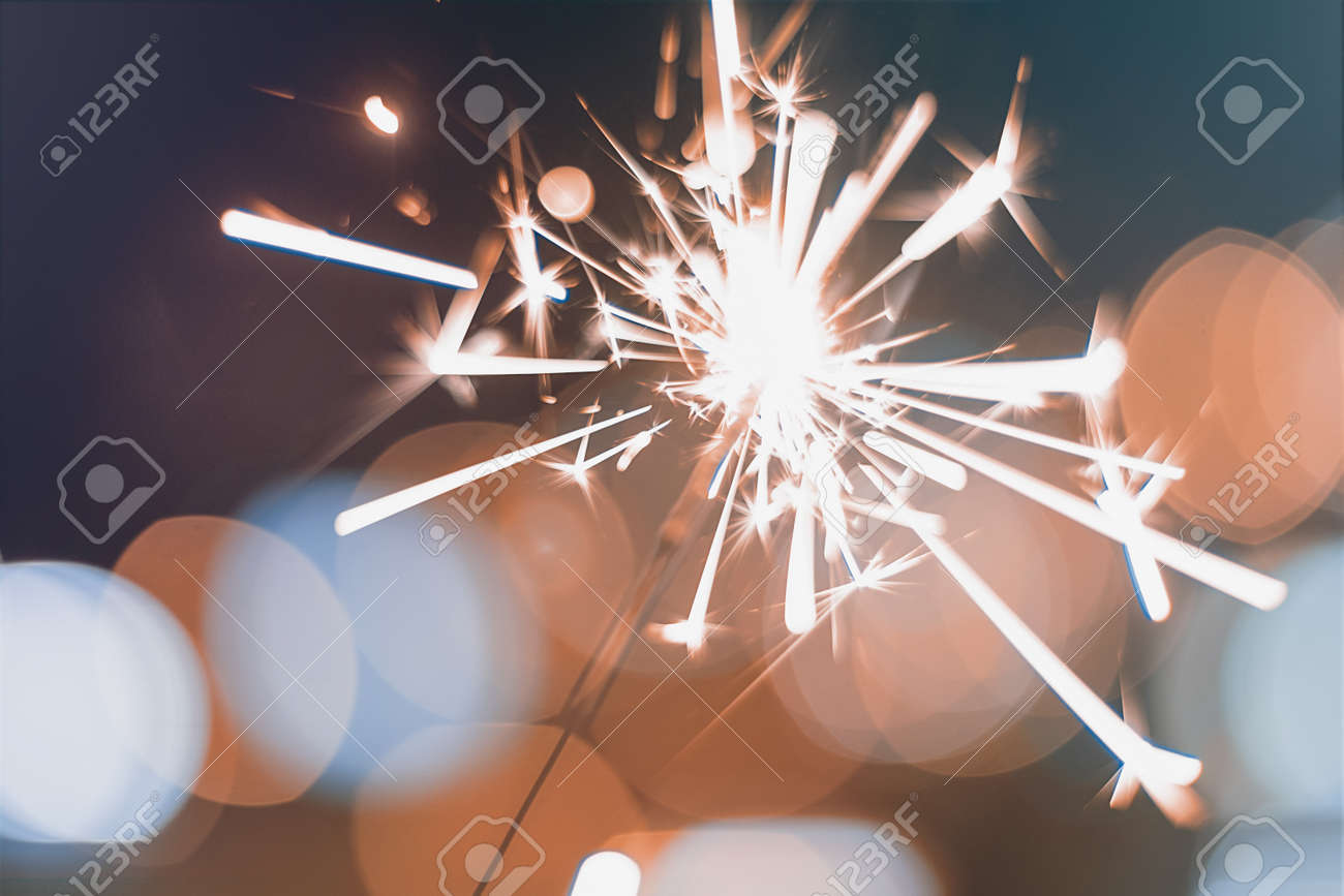 Night background with a sparkler. Sparkler Bokeh Colorful sparkler. Shallow focus - 68722495