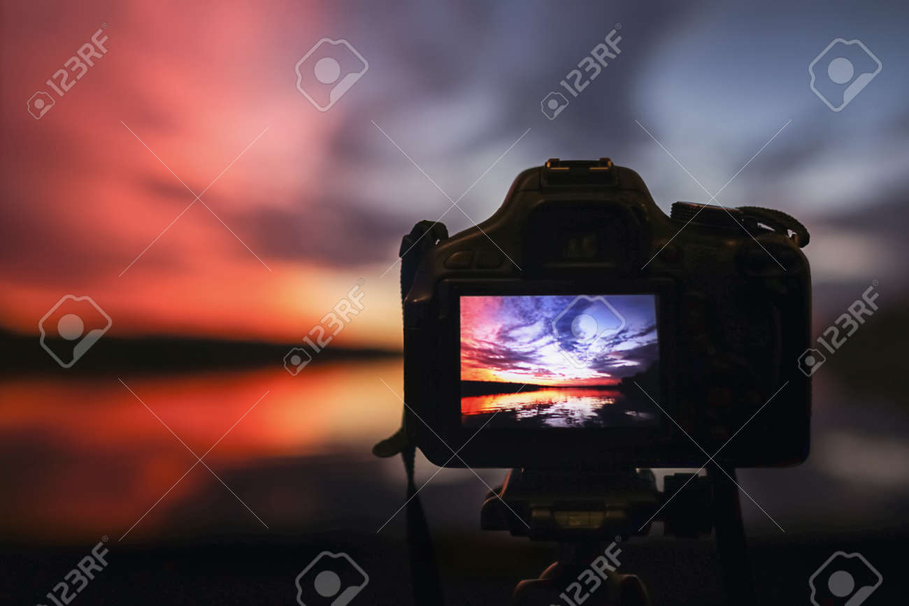 Camera capturing sunset. Photography view landscape. Camera the night view - 68723648