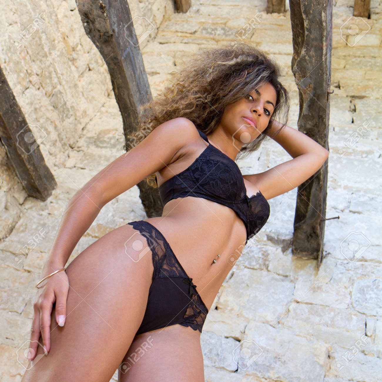 Model in black lingerie in an old house with exposed beams. Stock Photo - 10703220