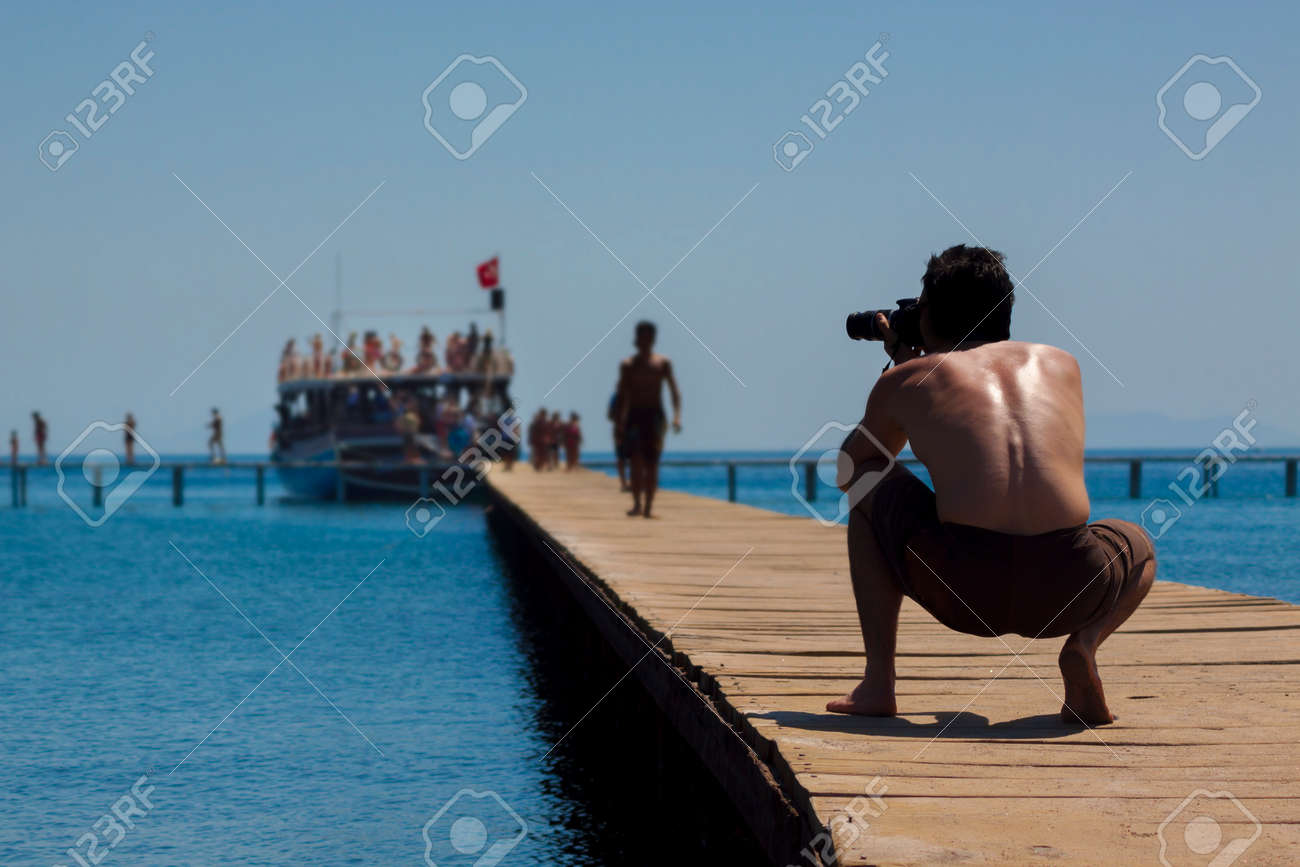 as passengers disembark from a cruise ship a photographer captures the action stock photo 37443885