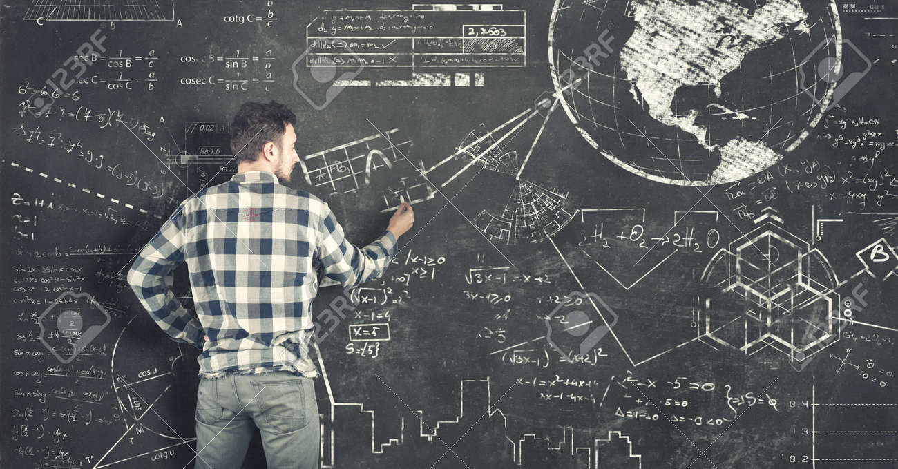 Teenager Solving Some Math Problems On Blackboard Stock Photo ...