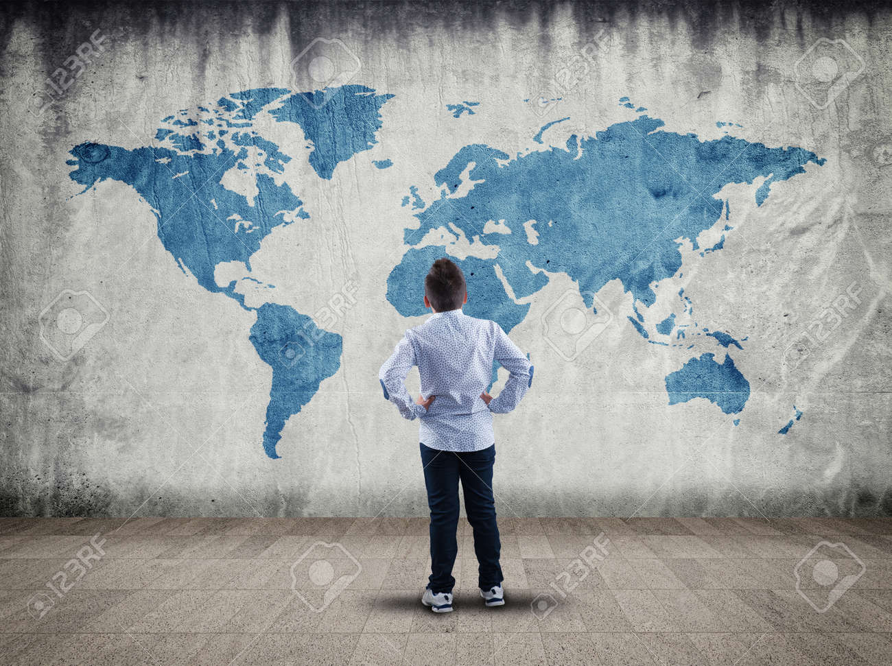 Boy sit back and look at the world map drawn wall stock photo boy sit back and look at the world map drawn wall stock photo 65225946 gumiabroncs Choice Image