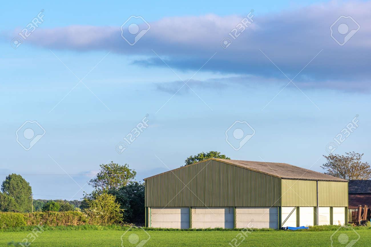 Prefabricated Farm Building In A Rural Setting On A Sunny Day With Blue Sky Fotos Retratos Imagenes Y Fotografia De Archivo Libres De Derecho Image 147580849