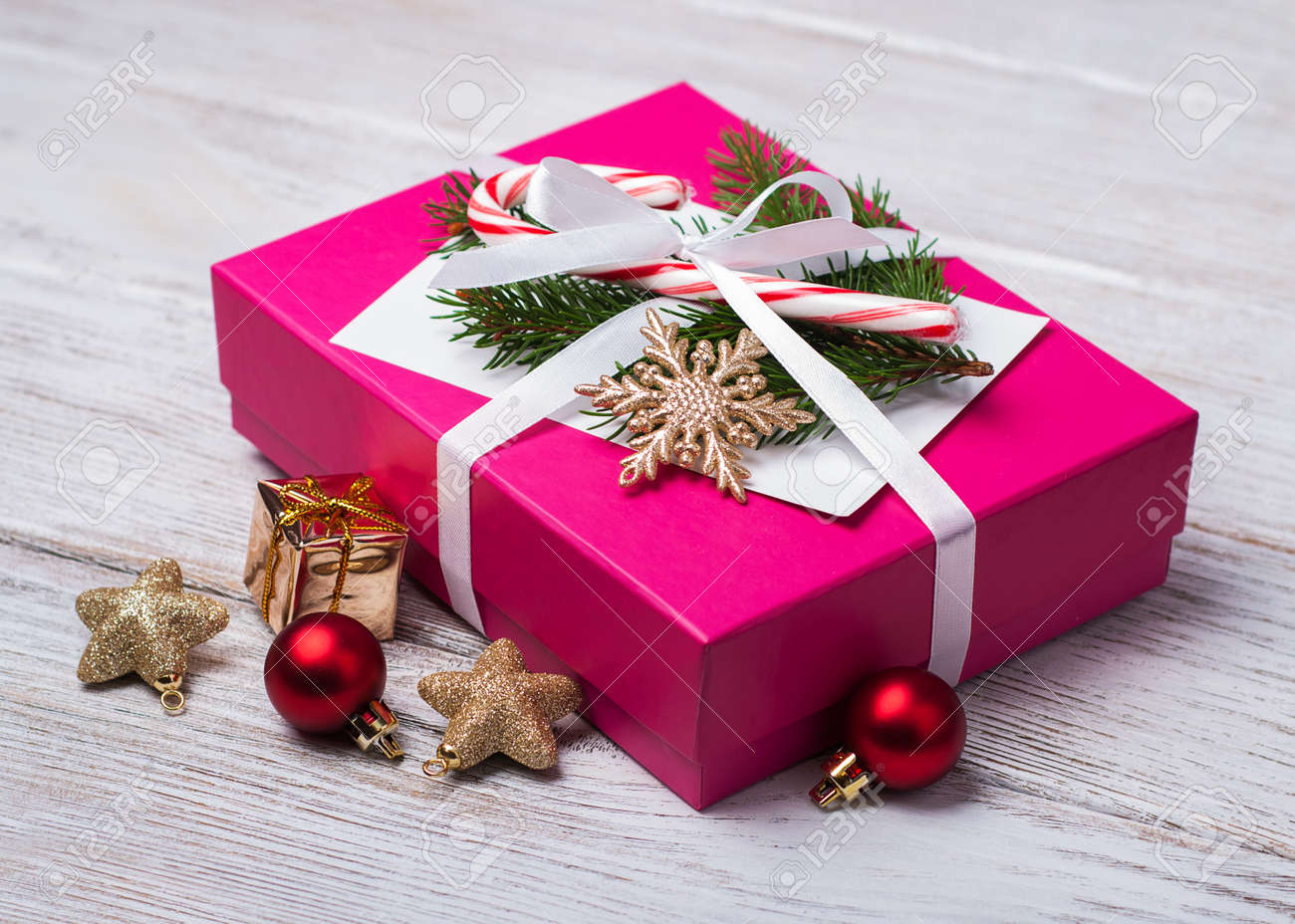 Christmas Gift Box And Decorations On A Old Wooden Table Stock Photo ...