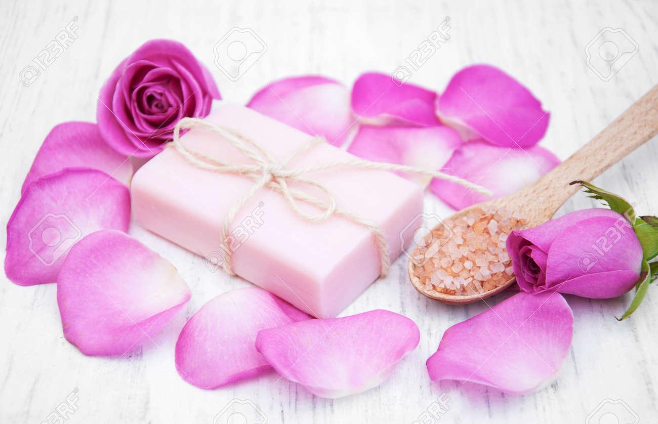 Handmade Soap, Massage Salt And Pink Rose On A Old Wooden Background ...