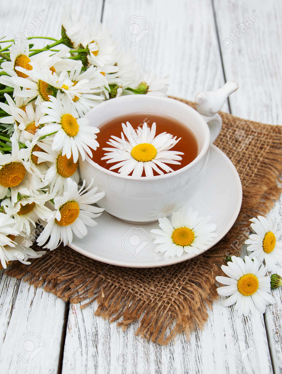 Cup Of Herbal Tea With Chamomile Flowers On A Wooden Table Stock