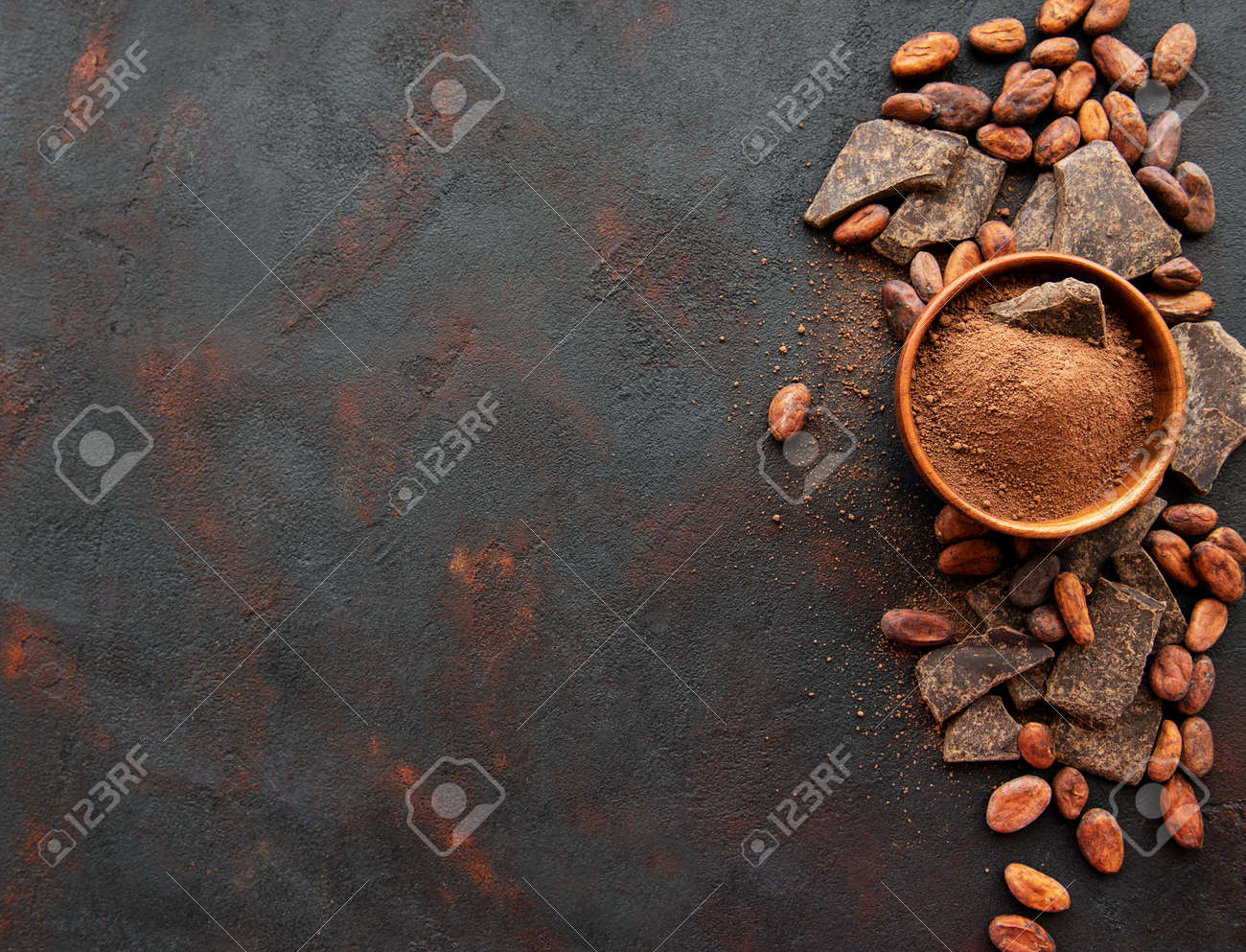 Natural cocoa powder and cocoa beans on a black background - 120051555