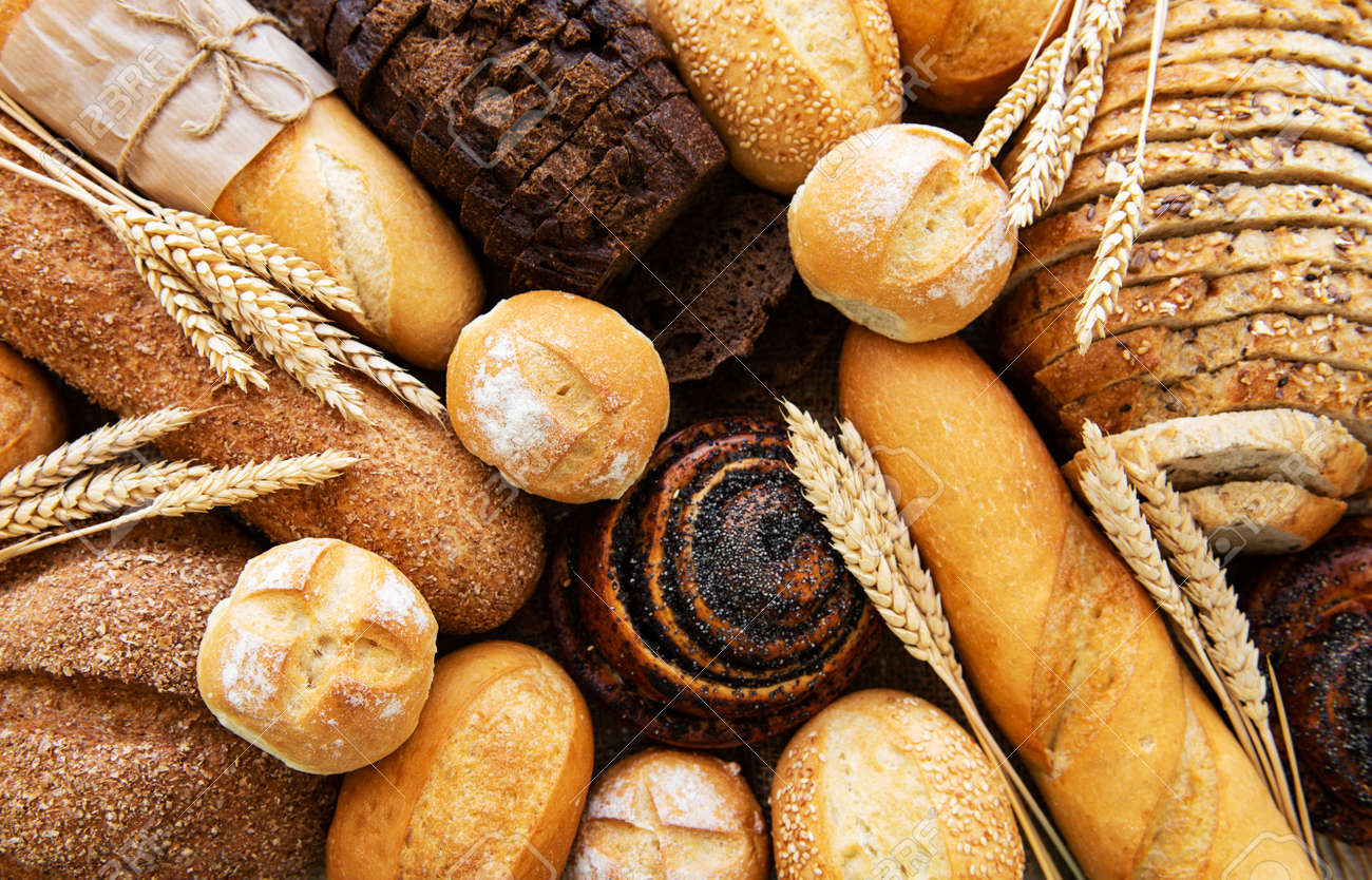 Assortment of baked bread as a food background - 128554599