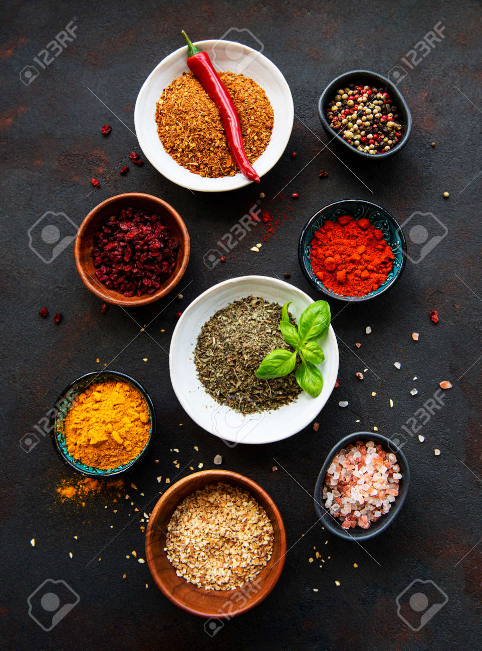 Various spices in a bowls on black concrete background. Top view copy space. - 155986733
