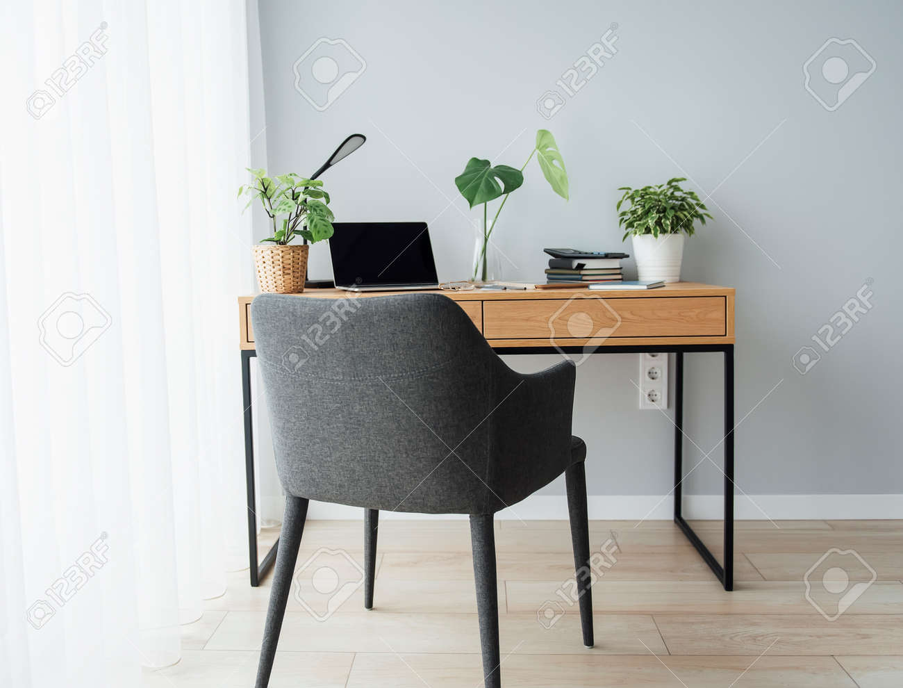 Office workplace with laptop on wooden table - 168964171