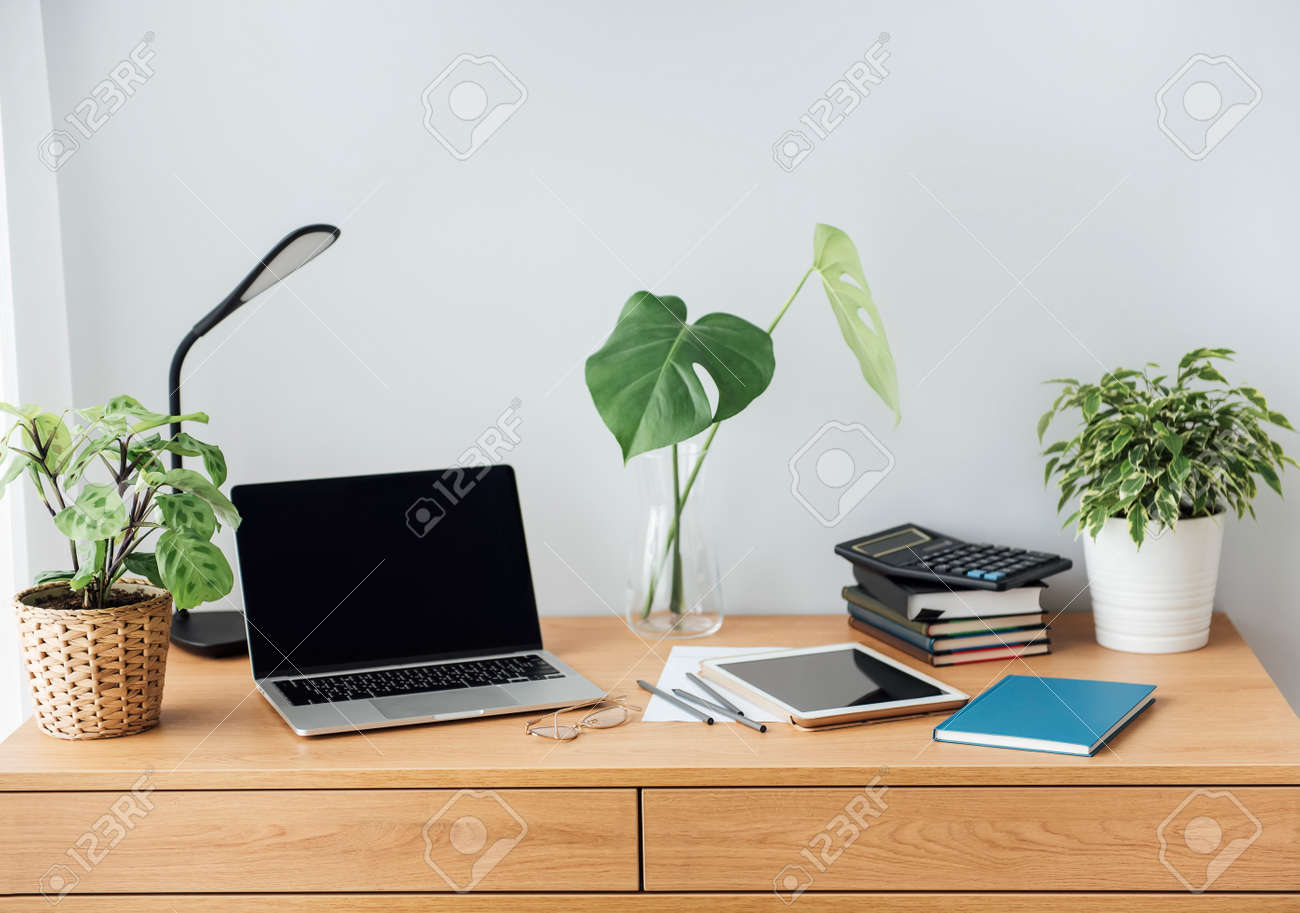 Office workplace with laptop on wooden table - 168964453