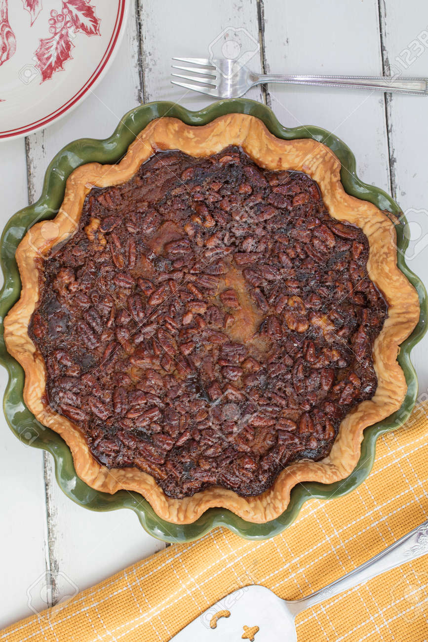Pumpkin Pecan Walnut Pie Baked For Thanksgiving In A Green And While Ceramic Plate