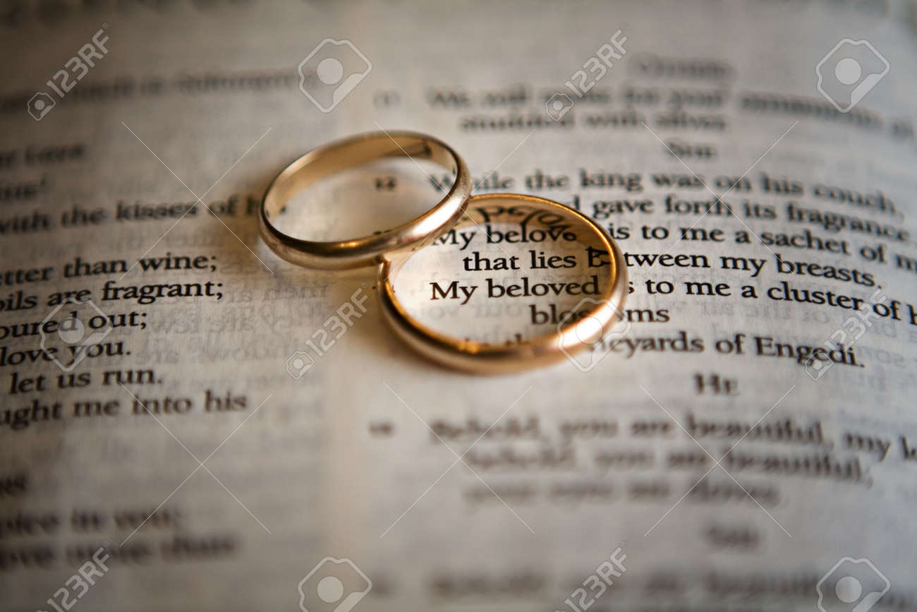 Two Golden Wedding Rings On A Bible Page Stock Photo Picture And