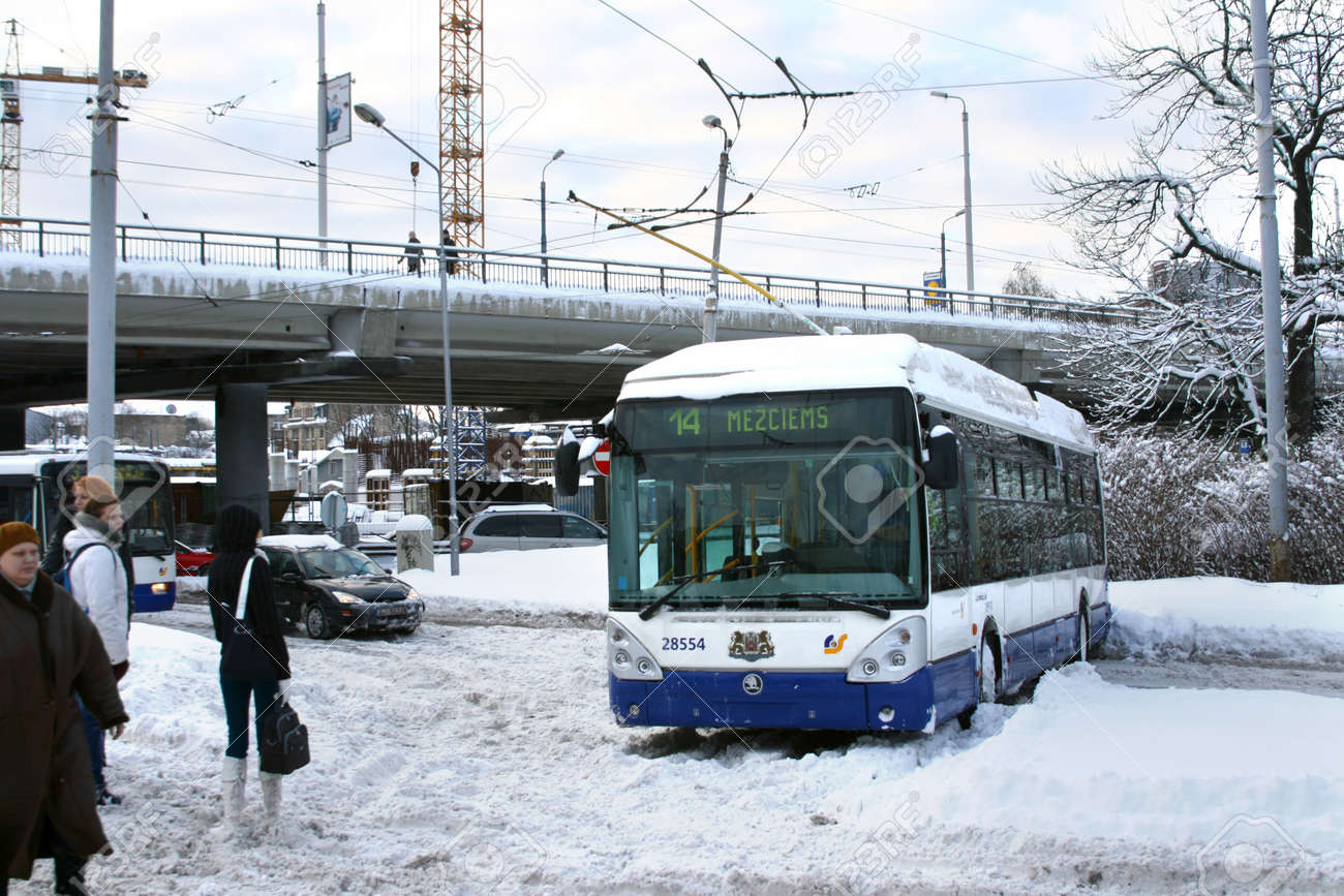 Dangerous traffic accident with public transport in Riga, Latvia on February 2, 2010. Trolleybus stuck in snow and blocked driving on slippery road. Massive snow in everywhere due to unbelievable winter storm in Europe. Luckly nobody is hurt. - 9386876