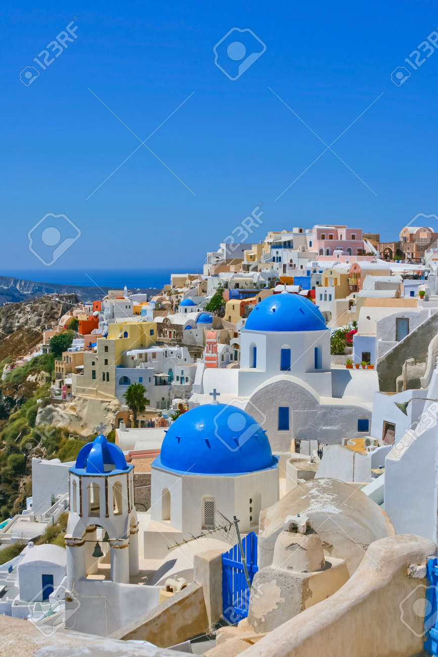 Magic view of Oia on island of Santorini in Greece. Traditional architecture with famous blue churches. - 9739464