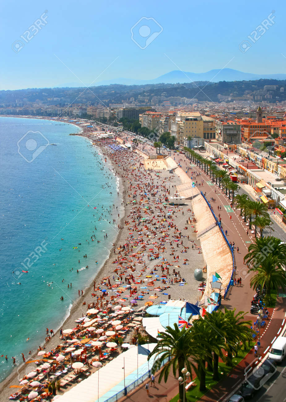 Luxury resort of French riviera. Fantastic panorama city of Nice in France. Sunny, summer day. Mediterranean sea, public beach, famous quay, palms and houses of Nice. - 10291300