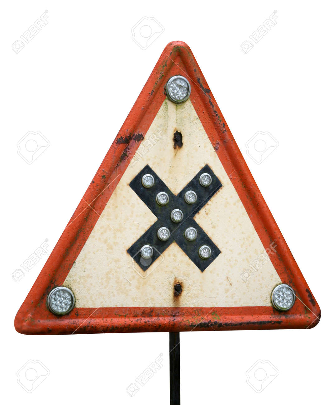 This sign warn of road crossings at even level. Crossroads with right-of-way from the right. This is rare and old sign is located in Latvia. Isolated on white close-up object. Clipping path included. - 10291121