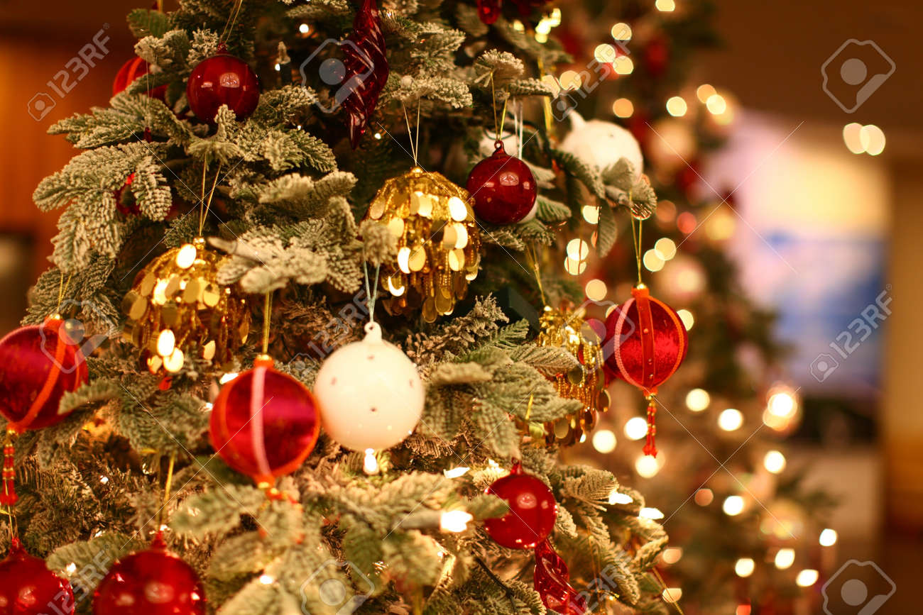 Christmas Tree Closeup With Beautiful And Colorful Ornaments Stock Photo