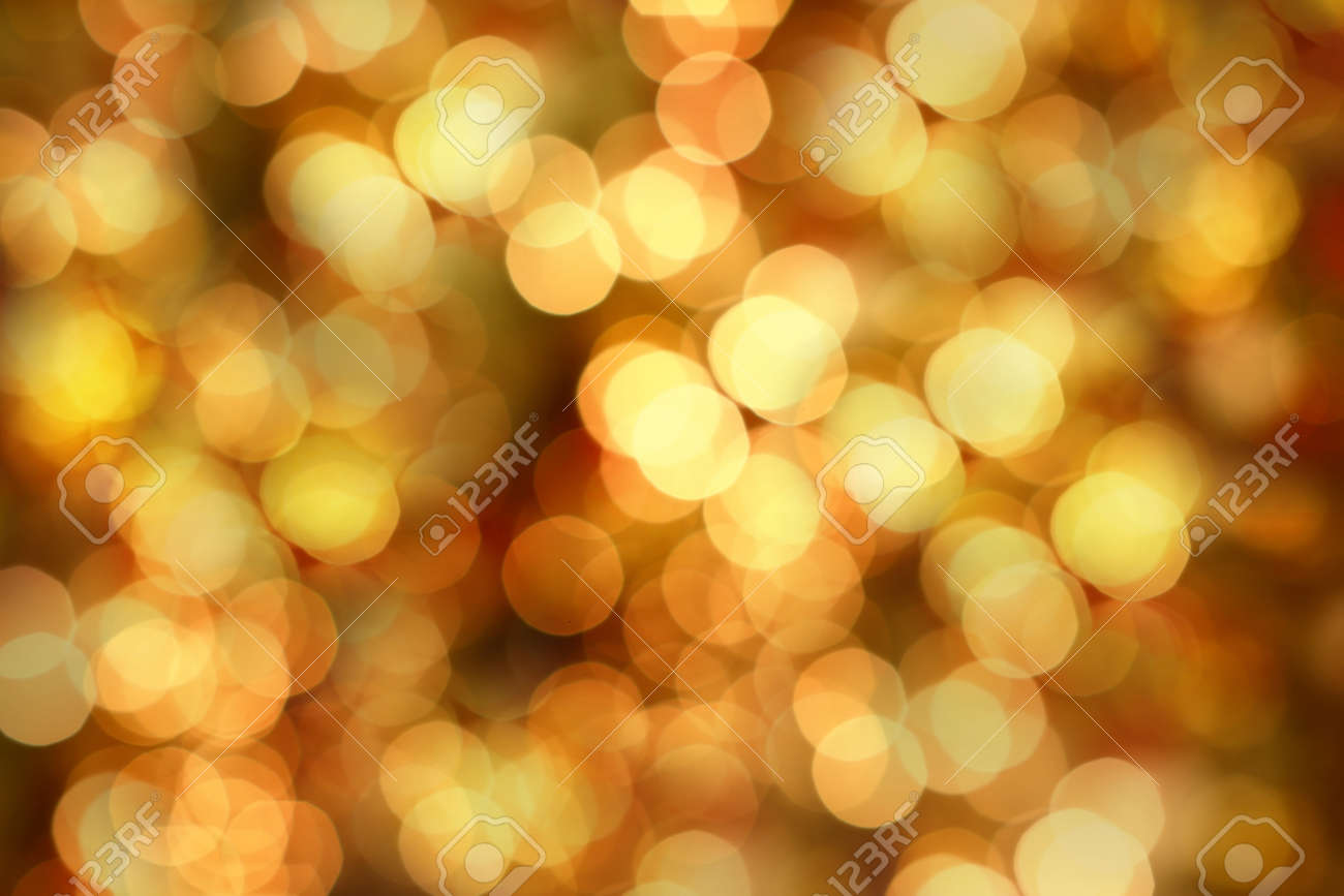 Golden Christmas lights at night. Beautiful blurred background. - 11865485