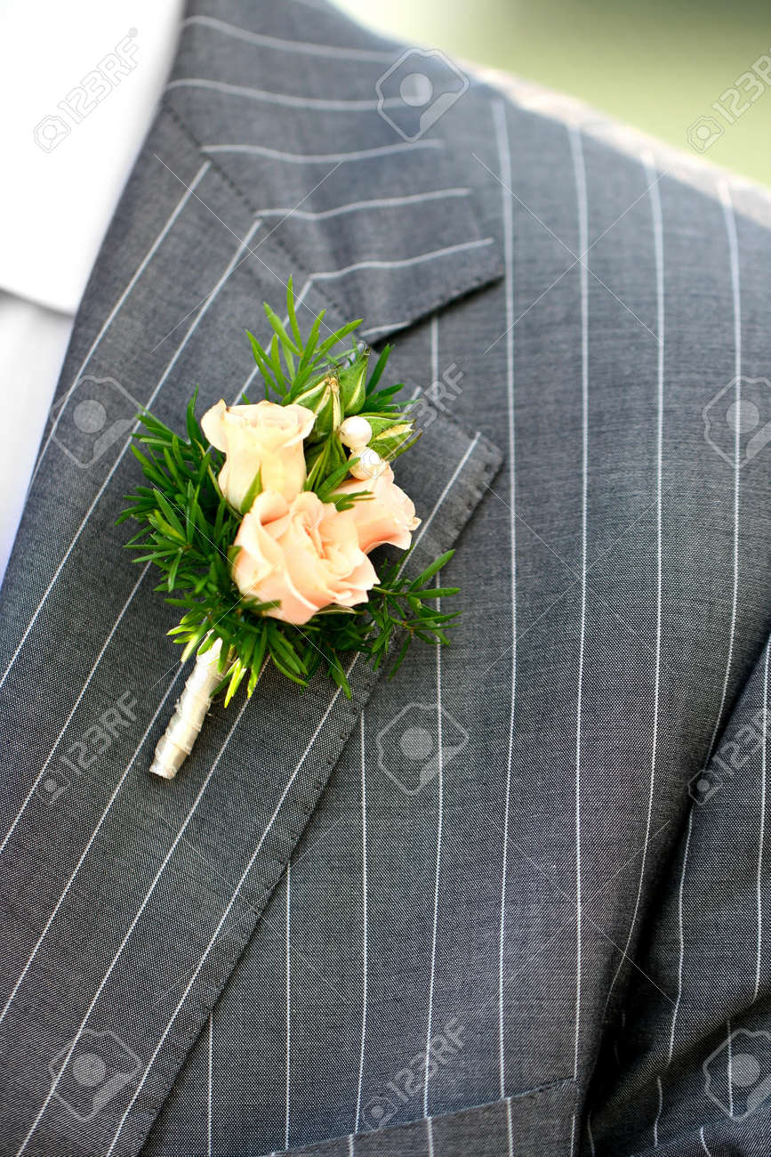 Wonderful wedding boutonniere on a costume of groom from beautiful colorful flowers. - 13100856