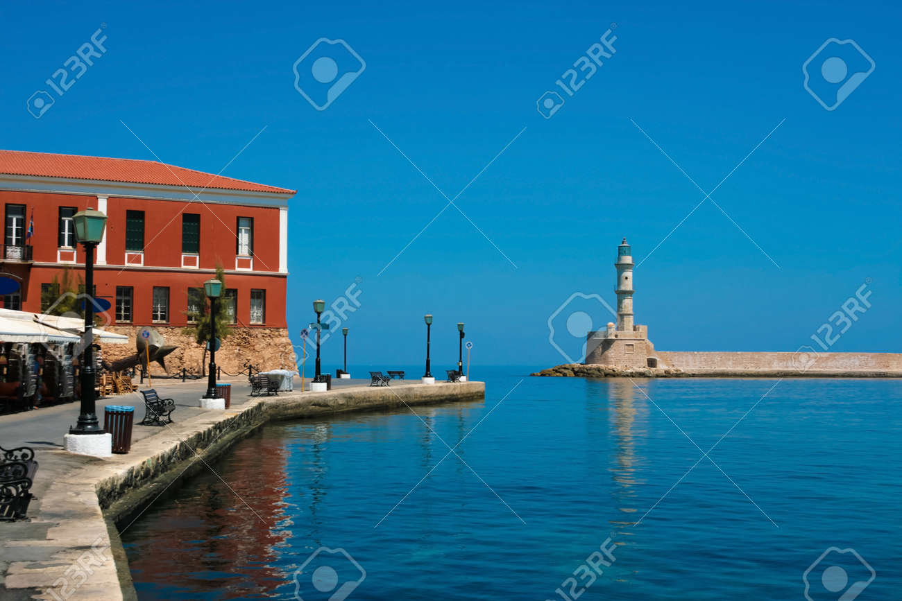 Beautiful promenade and famous lighthouse in city of Chania on island of Crete, Greece - 19299233