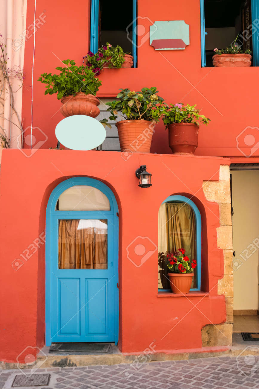 Colorful quiet backyard with beautiful flowers and classic traditional architecture in city of Chania on island of Crete, Greece - 19740671