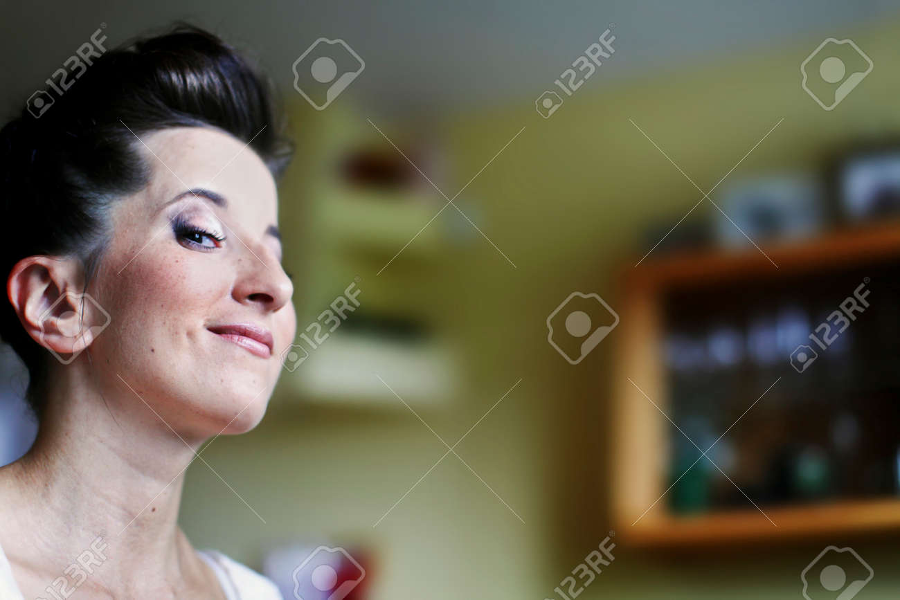 Bride's morning before the wedding. Process of makeup artist is finished. Bride is happy and waiting for the groom - 132657557