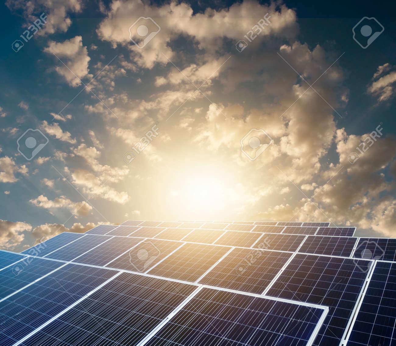 Sunset over Solar energy Farm plant. - 143702708