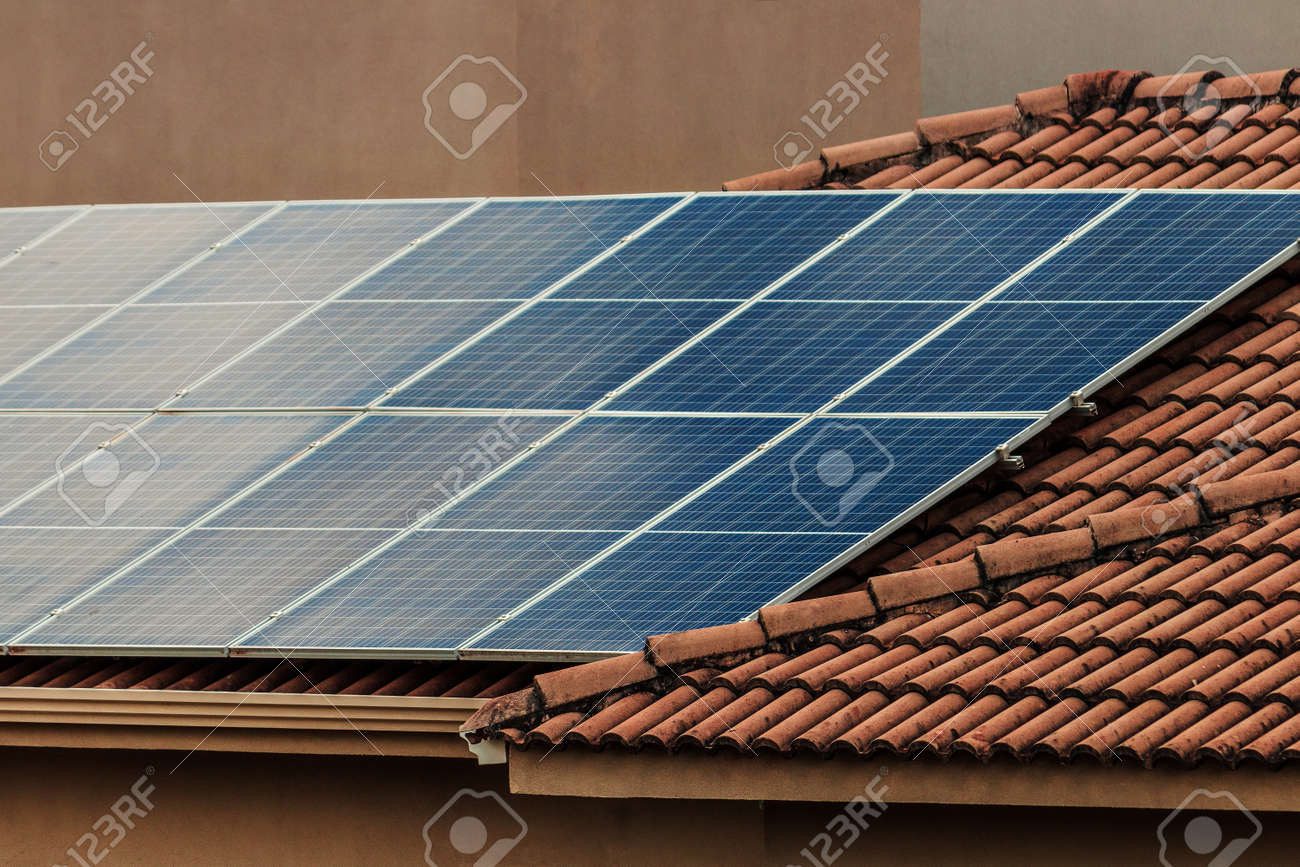 Solar photovotaic panel at a roof at suset. Solar energy house company concept image. - 166883689