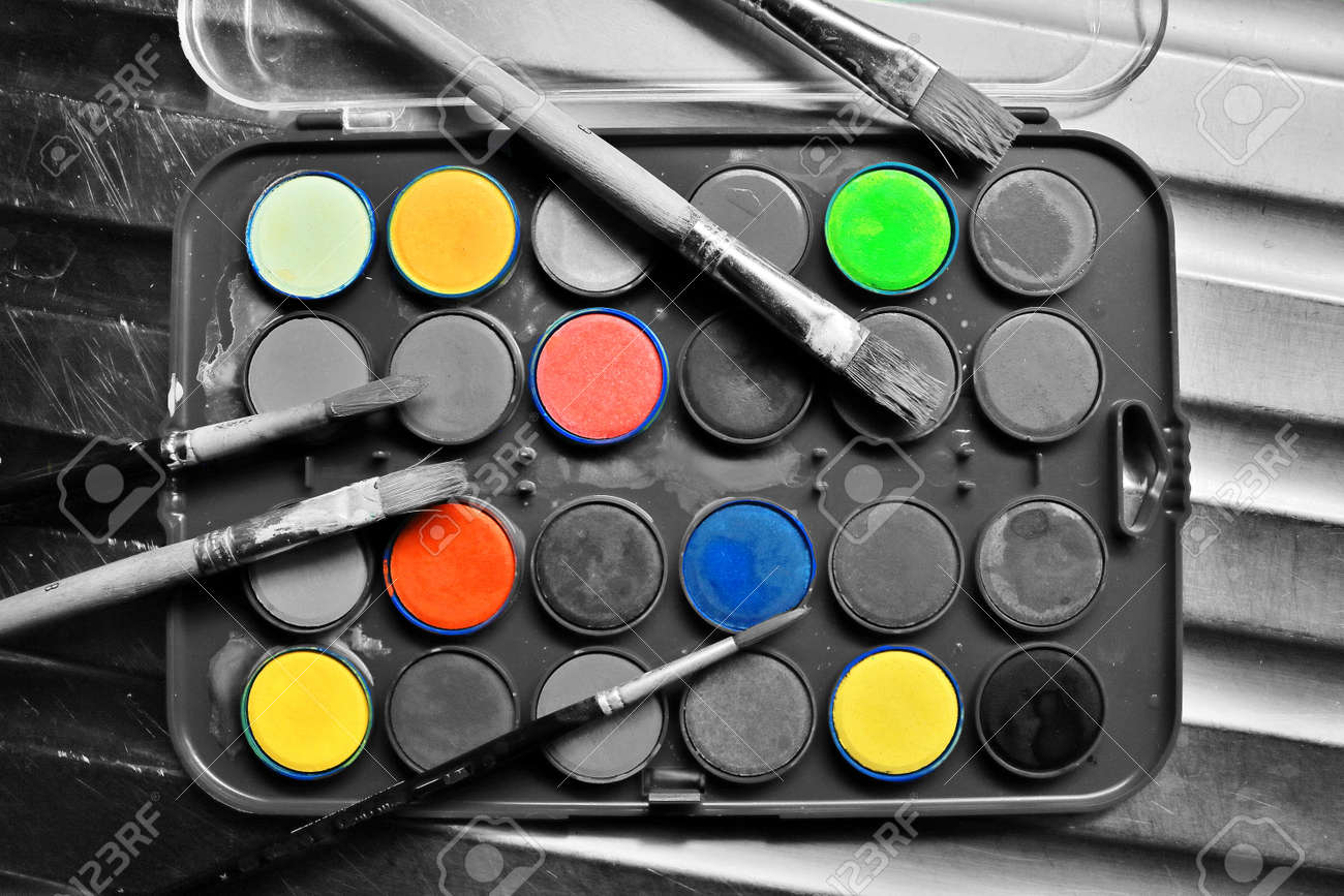 Stock photo watercolor set with brushes in black and white with a pop of color