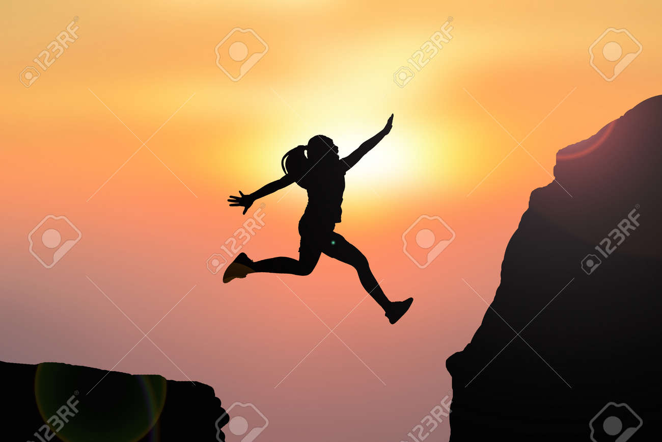 Silhouette women jumping on top mountain - 60169092