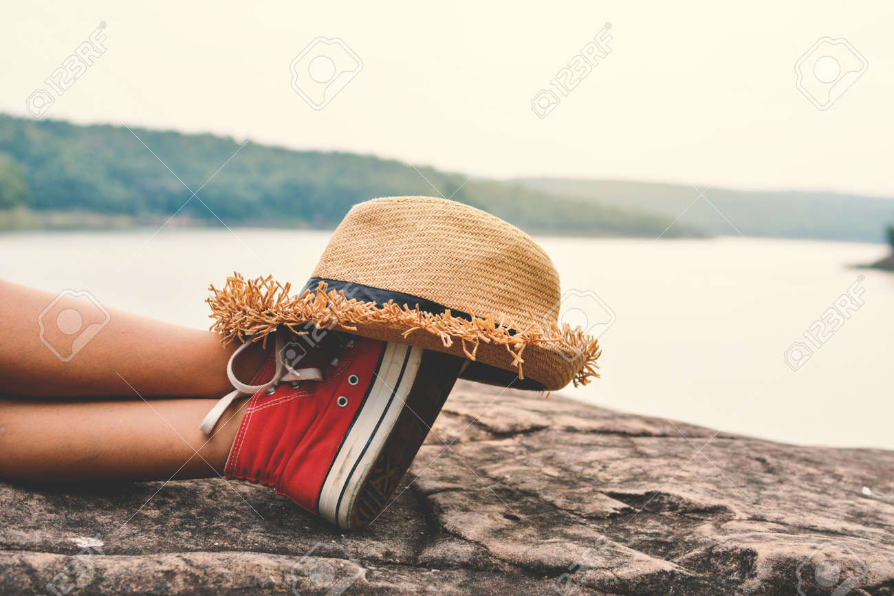 Feet of young girl sleep in the park on nature, Relax time on holiday concept travel ,color of hipster tone Stock Photo - 79021290