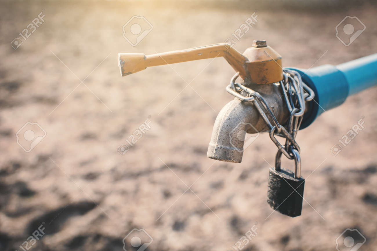 Key And Chain Locked Faucet On Cracked Dry Ground , Concept Drought ...