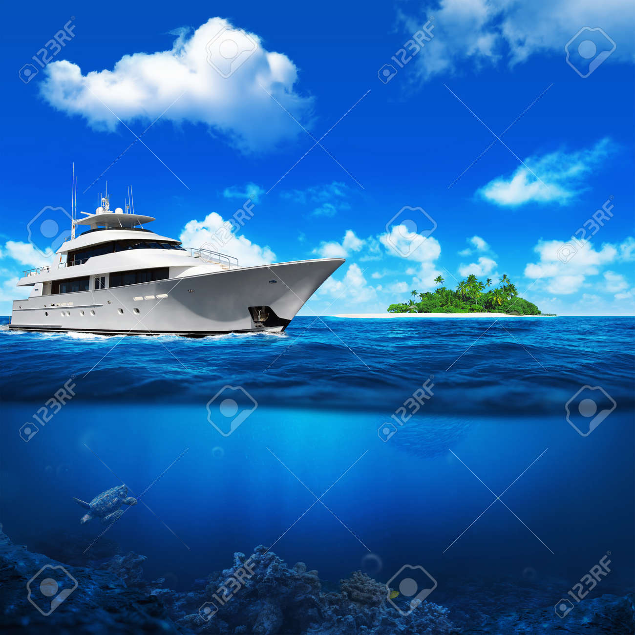 White yacht in the sea. Island with palm trees on the horizon. Turtle under water. - 44054010