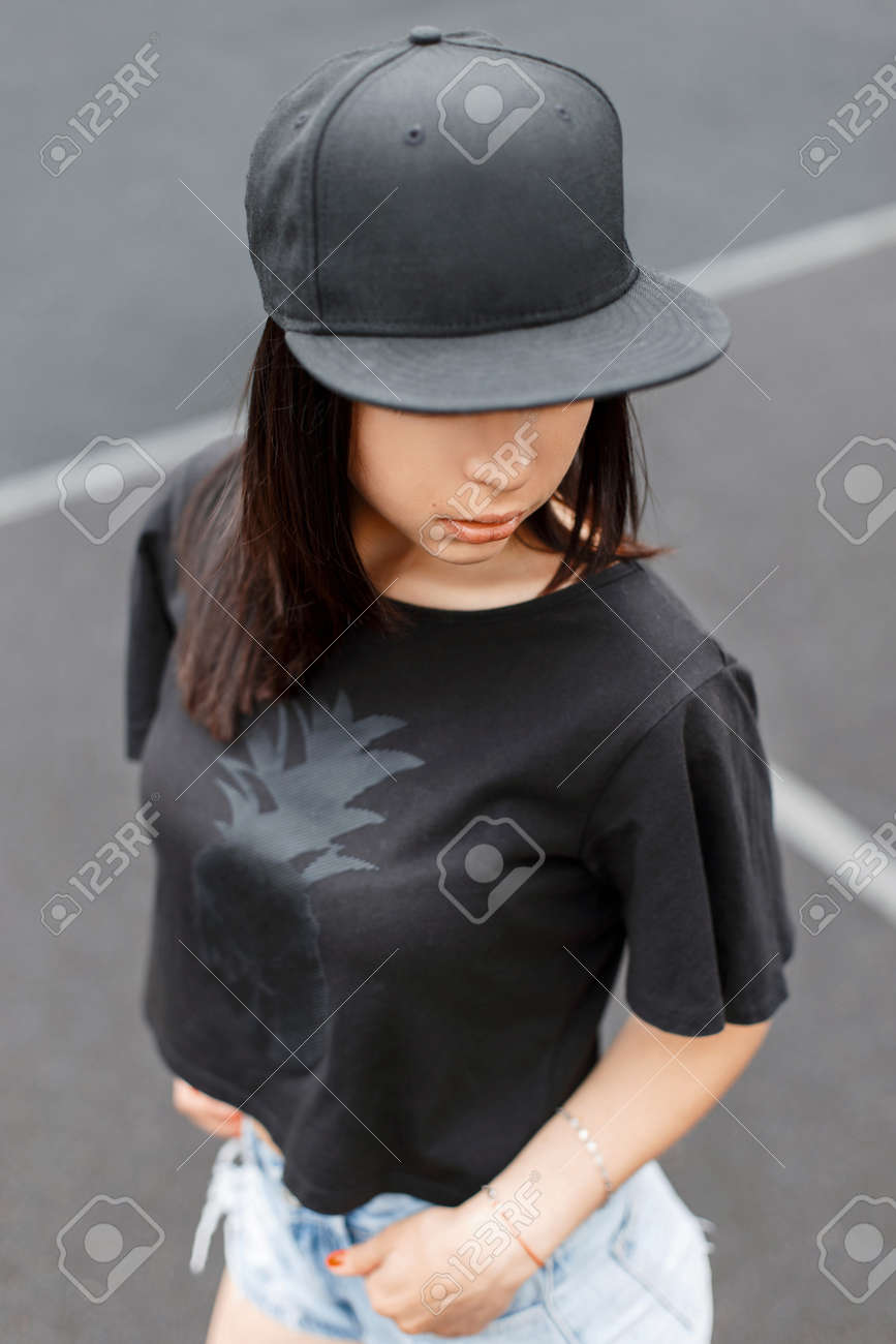 Beautiful Girl In Swag Style Black T Shirt And A Cap At The