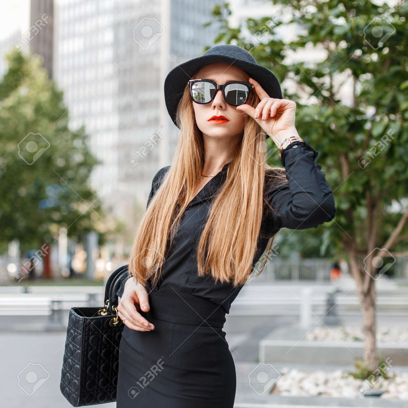 29d5ae09c Beautiful Stylish Girl In Black Clothes With Sunglasses And A ...