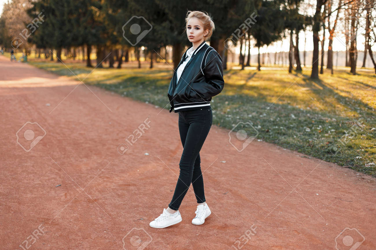 Beautiful Young Woman In A Stylish Jacket Black Jeans And White