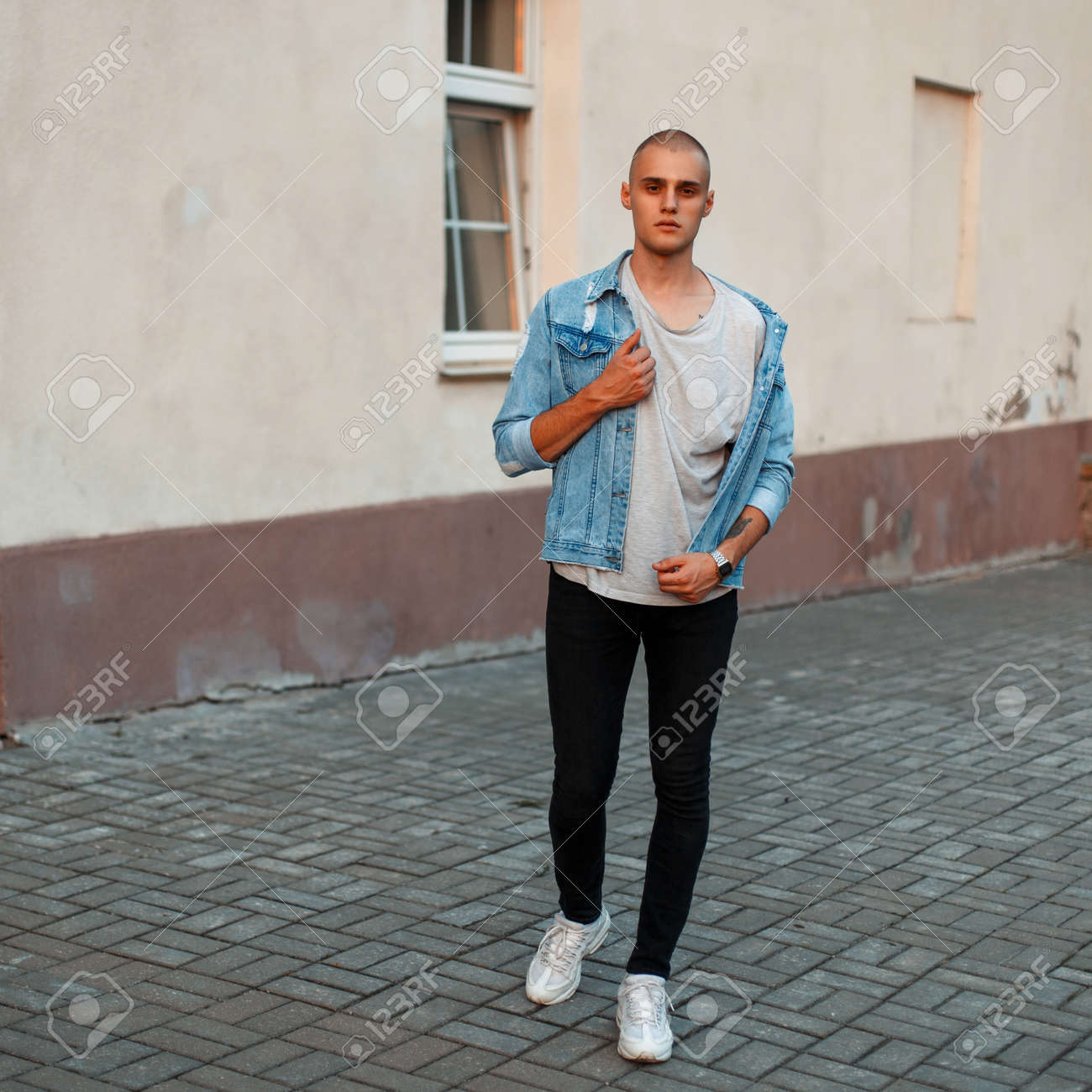 71fb72bc8a Stock Photo - Stylish young man in a denim jacket