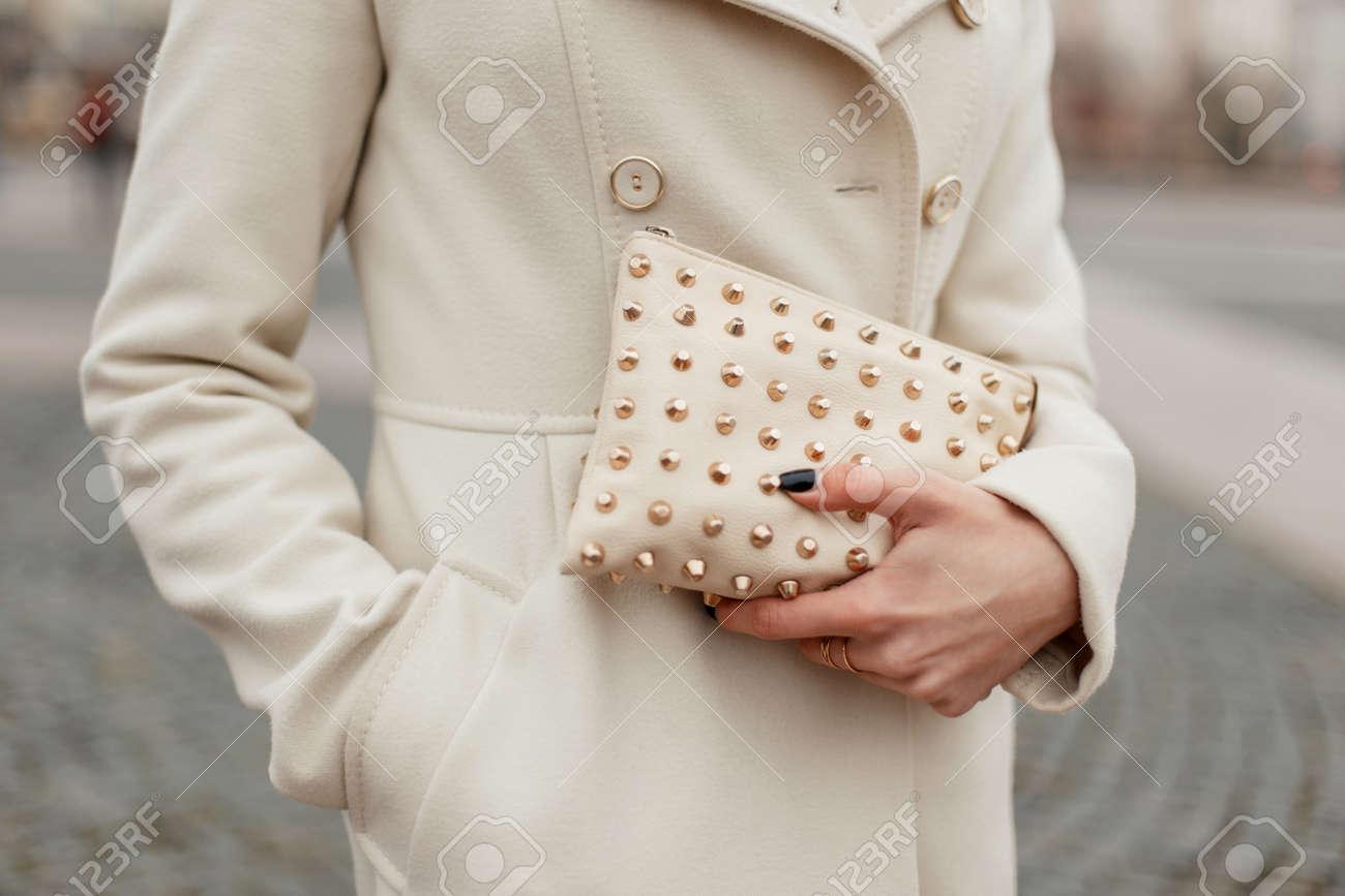Fashionable stylish women s handbag in women s hands on the street Stock  Photo - 90927390 f877ca244