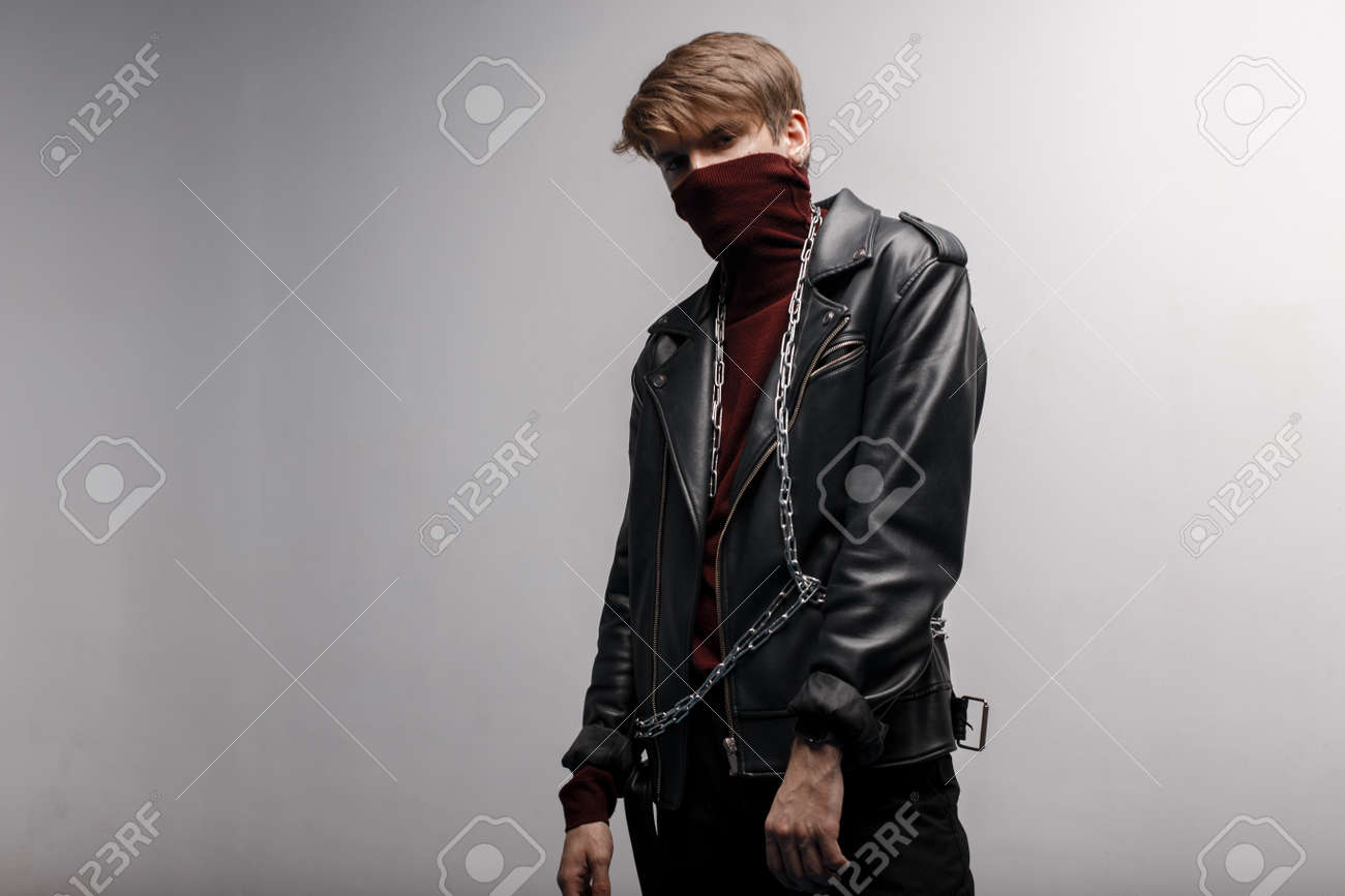 cheap price size 40 another chance Cute young man wearing burgundy trendy golf in a black leather..