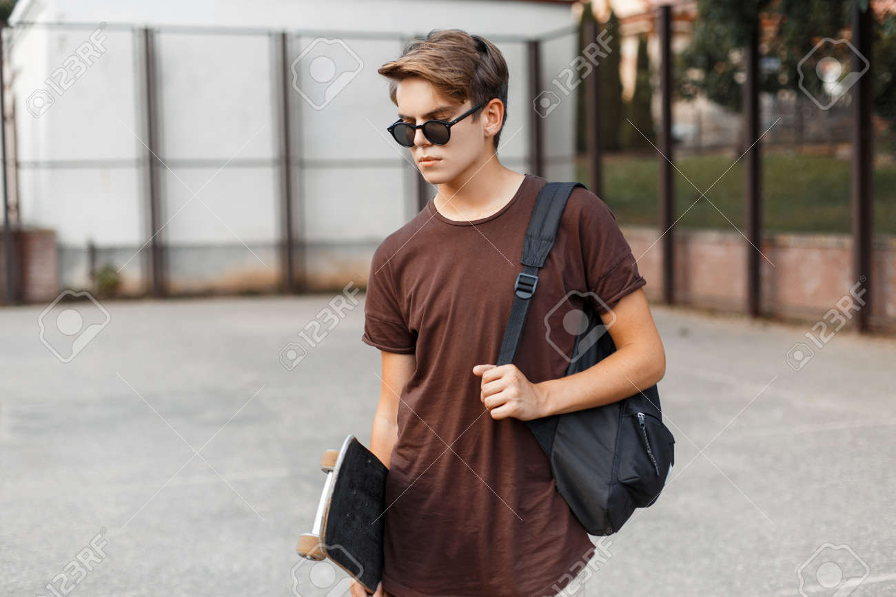 American young hipster man in stylish sunglasses in a summer