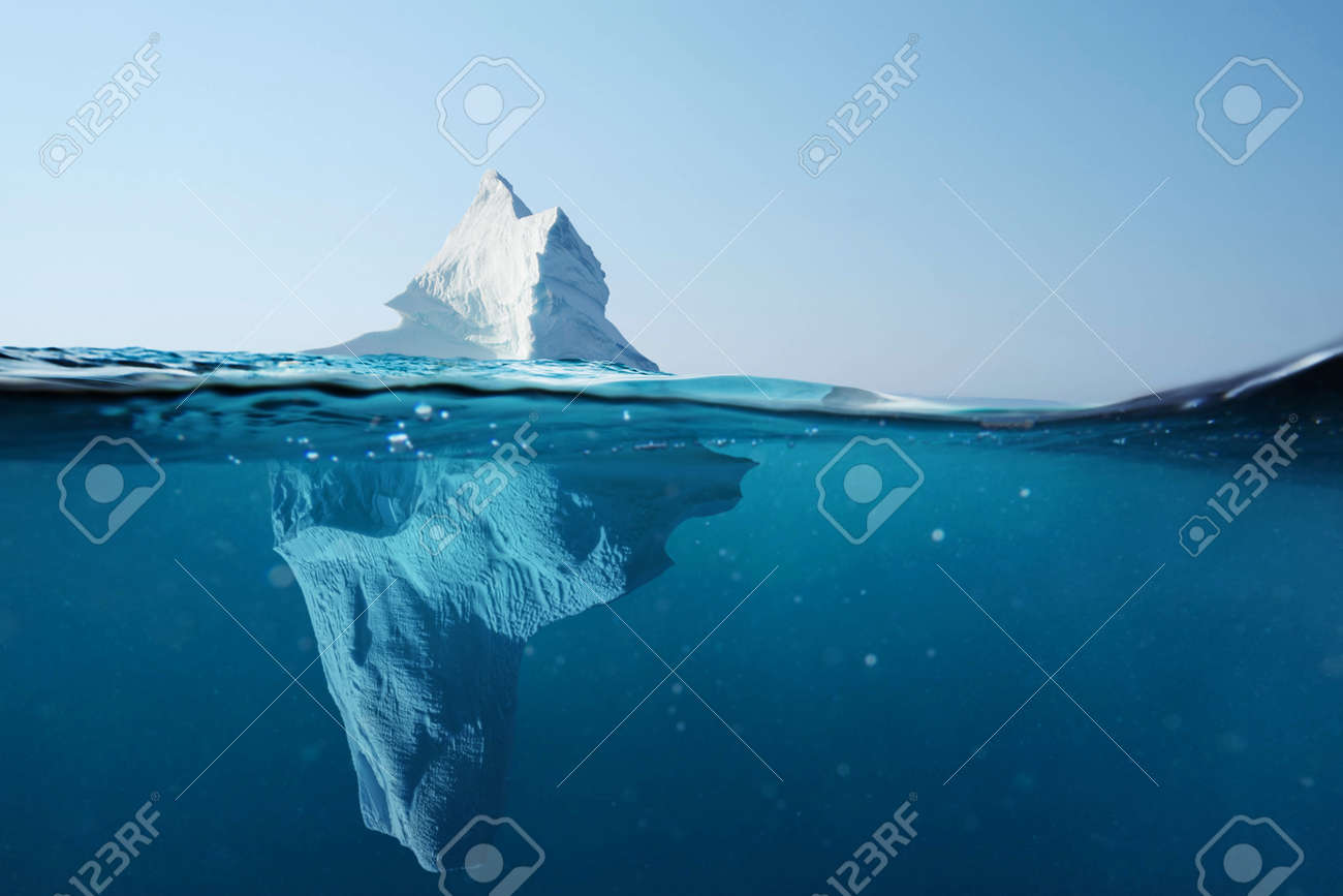 Iceberg in the ocean with a view under water. Crystal clear water. Hidden Danger And Global Warming Concept - 125232818