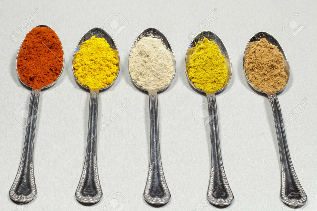 Tablespoons Of Different Types Of Spice Powders And Food Coloring ...