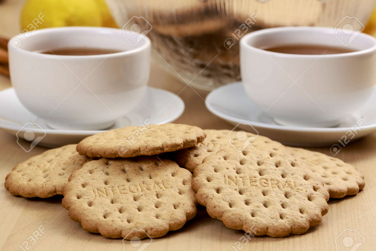 Low Calorie Cookies In Front Of Pu Erh Tea Cups Ideal Afternoon Stock Photo Picture And Royalty Free Image Image 71776901