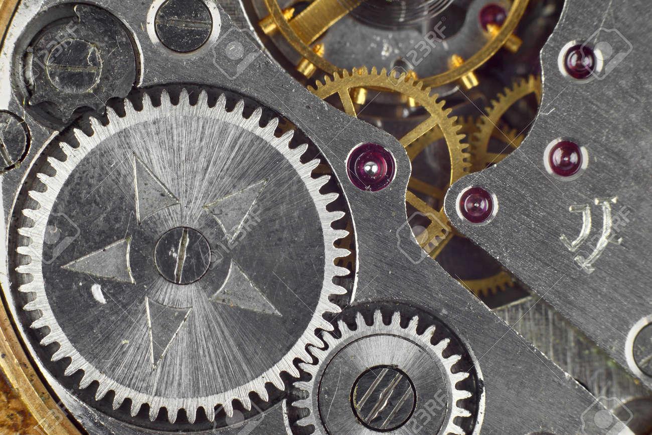 Clockwork details, pinions and wheels macro closeup wallpaper Stock Photo - 16113681