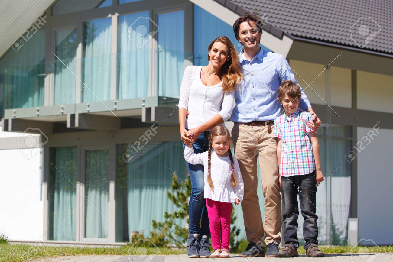 happy family standing in front of the house - 42174676