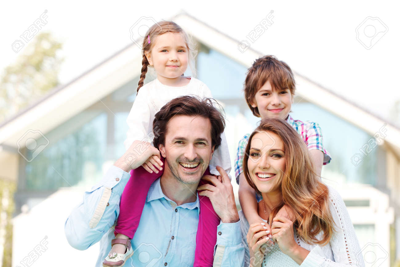 happy family standing in front of the house - 42608294