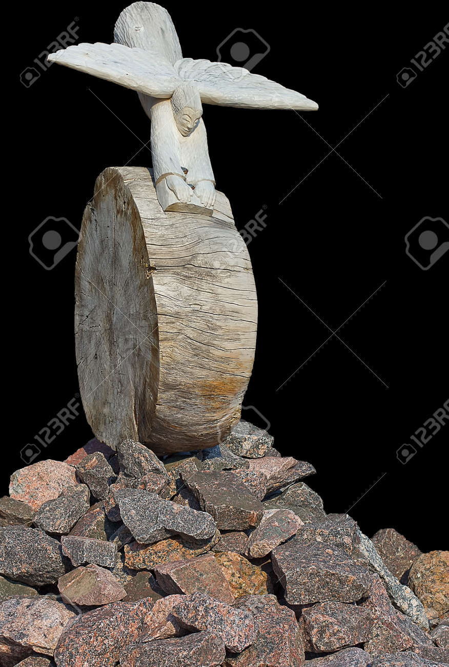 separated abstract figure of an wooden figure like an angel flying and rolling down from the stone mountain Stock Photo - 13725486
